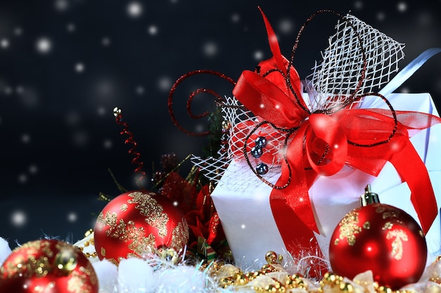 Christmas gift in a box on a dark festive background . photo with copy space