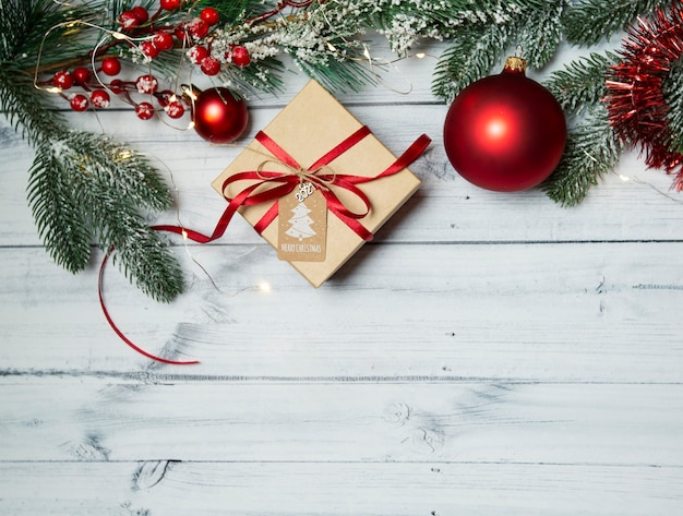 Christmas gift box and decoration on a wooden table, top view