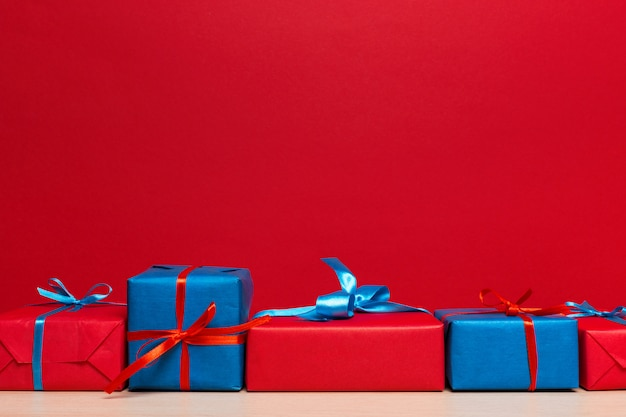 Christmas gift box on tablet, background with copyspace