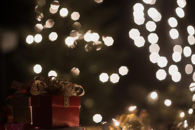 Christmas gift box with bokeh lights background