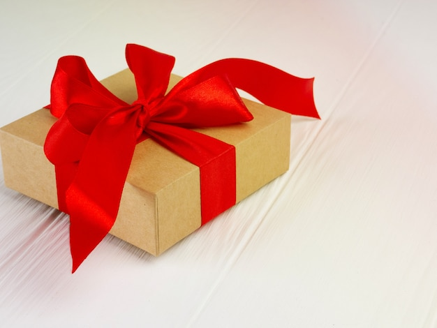 Christmas gift box with red bow and copy space