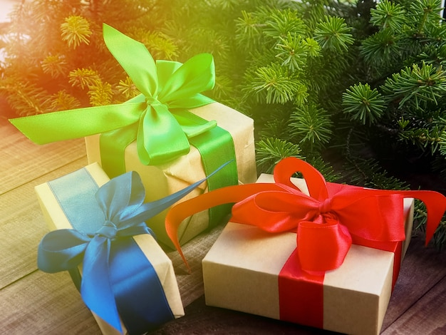 Christmas gift box with red ribbon on wooden, christmas presents with decorations