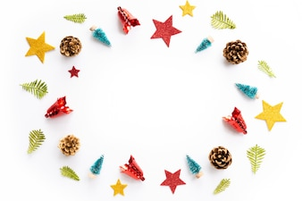 Christmas gift box with red star and pine cones on white background.