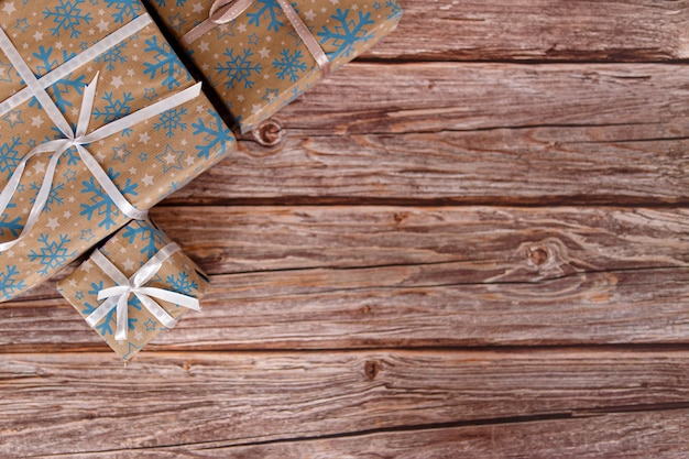Christmas gift box on wooden table with christmas ornaments, closeup.