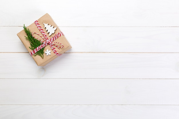 Christmas gift box wrapped in recycled paper, with ribbon top view  on rustic ,