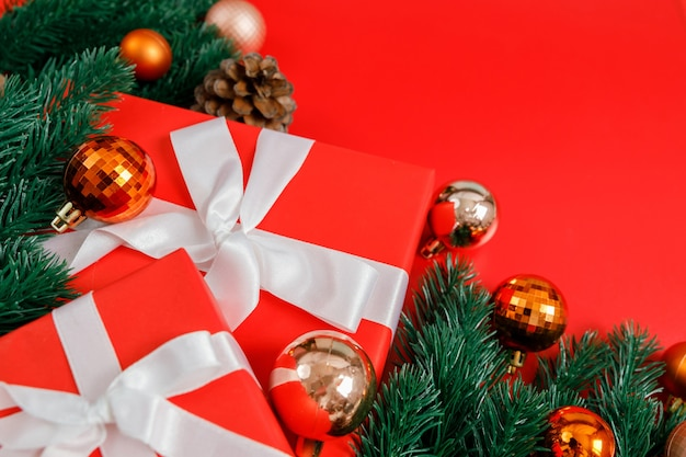 Christmas gift boxes, baubles and fir branch, closeup