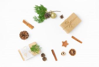 Christmas gift boxes in craft paper pine cones juniper cinnamon ornament ball