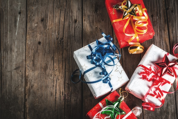 Christmas gift boxes, old rustic wooden background