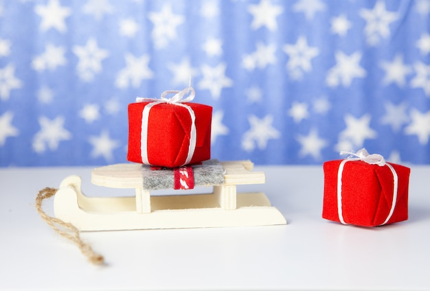 Christmas gift boxes on santa claus sleigh, on blue background