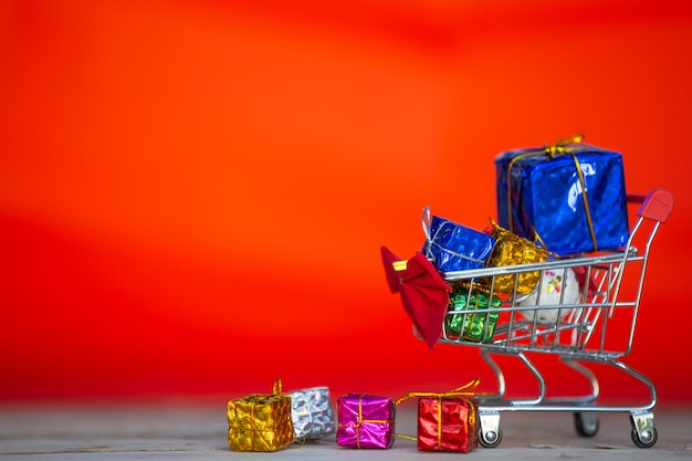 Christmas gift boxes in various colors placed in a shopping cart