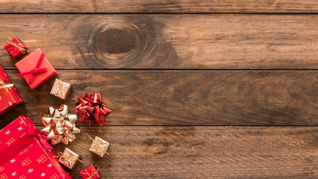 Christmas gift boxes with bows on table