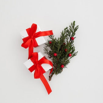 Christmas gift boxes with a mistletoe leave