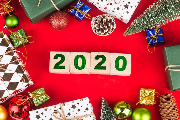 Christmas gift boxes with year 2020 on wooden blocks, preparation for holidays. top view