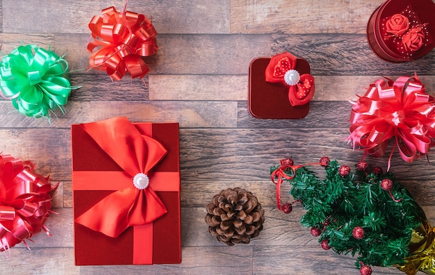 Christmas gift boxes and  on wooden background.