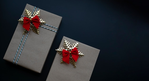 Christmas gift boxes wrapped by brown paper and christmas ornaments