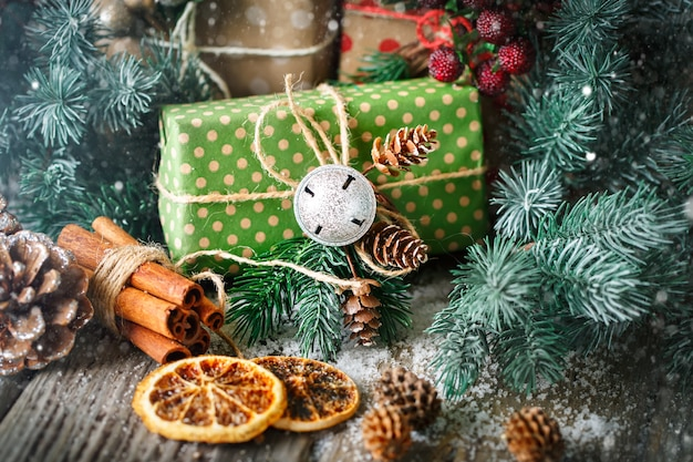 Christmas gift and christmas tree on dark wooden background