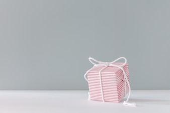 Christmas gift Festive pink box on gray background