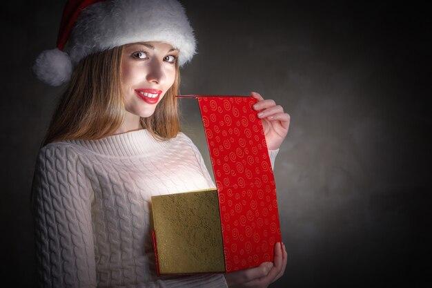Christmas gift.holidays magic. happy girl opening a gift box
