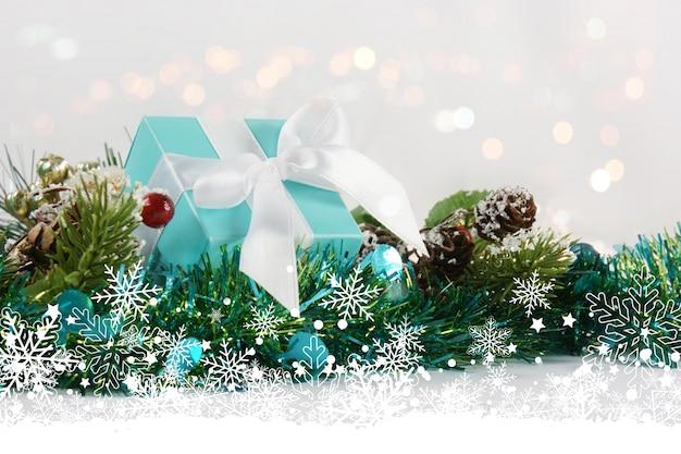Christmas gift nestled in tinsel