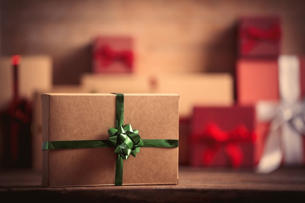 Christmas gift and other presents on wooden table