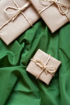Christmas gift packs on green tela