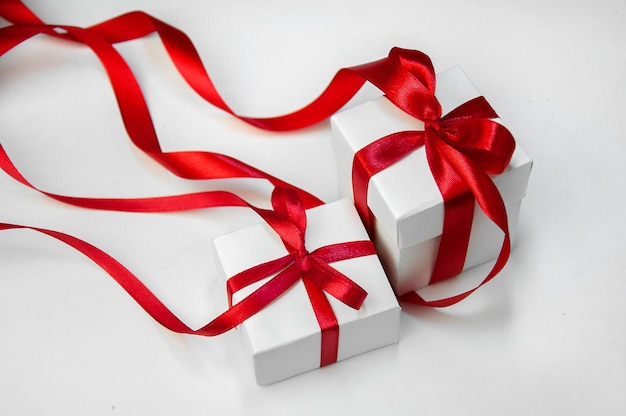 Christmas gift's in white box with red ribbon
