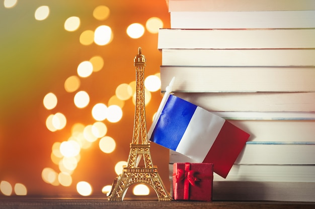 Christmas gift with eiffel tower toy and pile of books