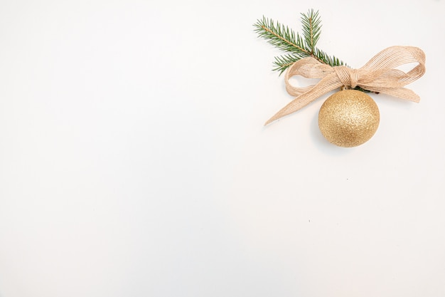Christmas gift with gold balls bow isolated on white background