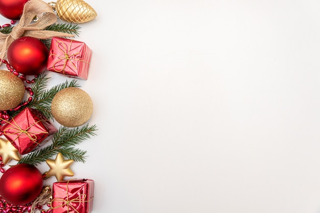 Christmas gift with gold and red balls bow isolated on white background