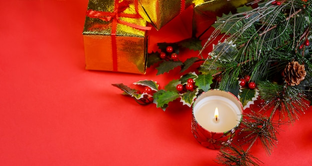 Christmas gift with holiday decorations, light background