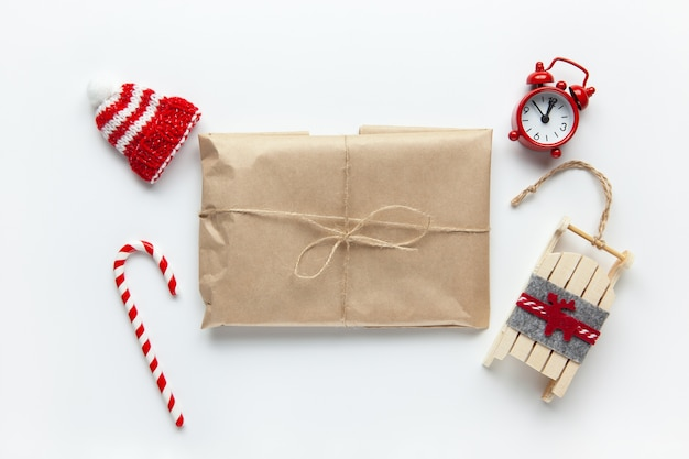 Christmas gift wrapped in brown craft paper, tied with scourge, with cane candy,