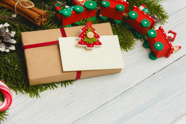 Christmas gift wrapped in kraft paper on christmas decoration