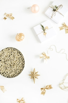 Christmas gifts and baubles on white background. flat lay, top view