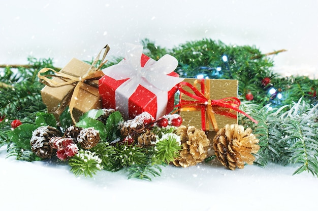 Christmas gifts and decorations with snow overlay