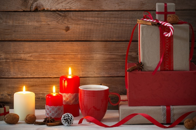 Christmas gifts and decorations on wood