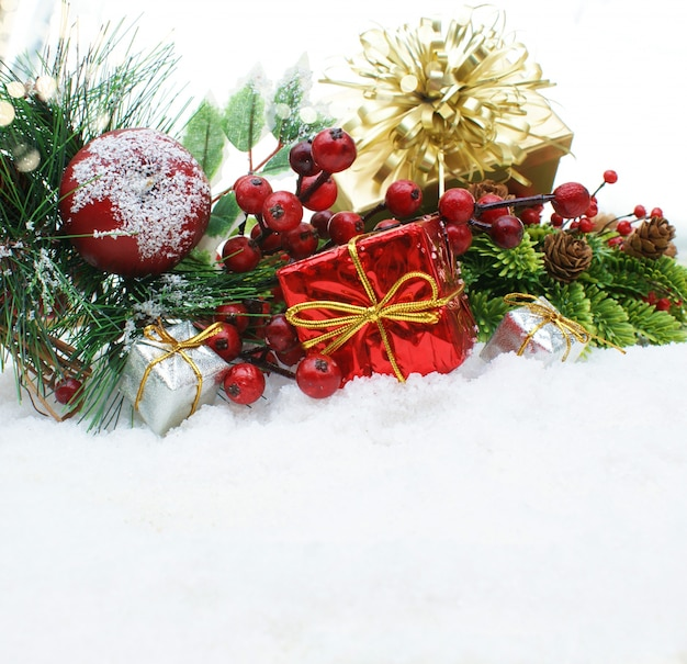 Christmas gifts and decorative objects nestled in snow