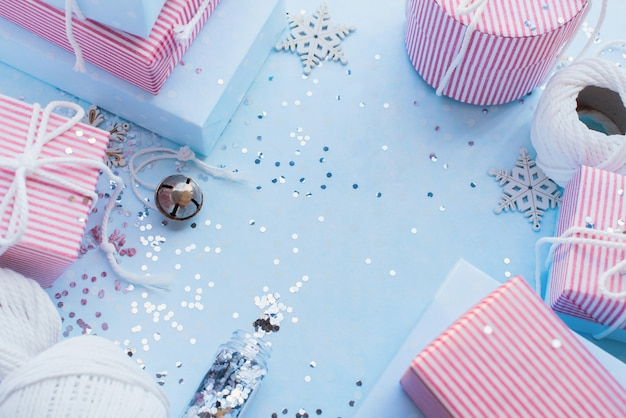 Christmas gifts. festive pink box blue background