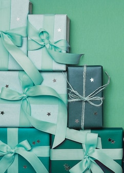 Christmas gifts on green background and ribbon