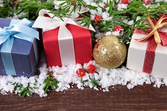 Christmas gifts on wooden board