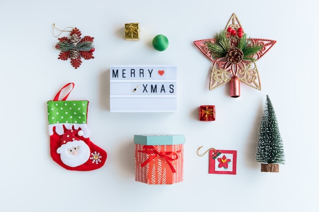 Christmas gifts, ornaments and decorations collection on white background, flat lay, top view