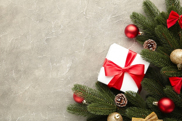 Christmas gifts presents with decorations on a grey concrete background.