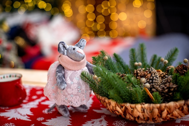 Christmas gifts symbol of the new year. the rat is handmade from fabric. new year cozy background. free space for text
