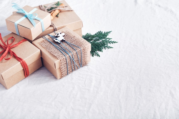 Christmas gifts on white crumpled fabric. zero waste holidays.