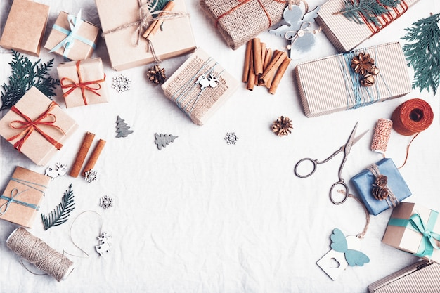 Christmas gifts on white crumpled fabric