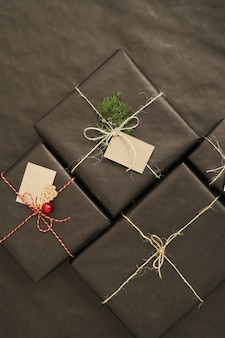 Christmas gifts with black wrapped paper