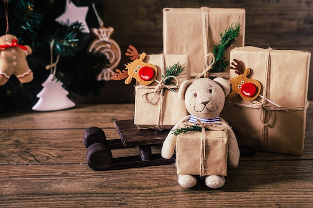 Christmas gifts with boxes on wooden background.