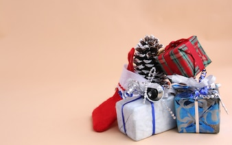 Christmas gifts with light yellow background.