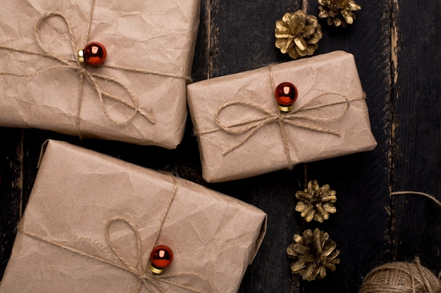 Christmas gifts with new year decoration on a wooden surface