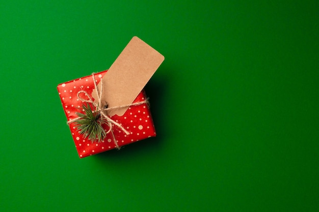 Christmas gifts with paper tag top view copy space