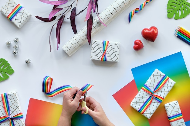 Christmas gifts with rainbow ribbon in lgbtq flag colors